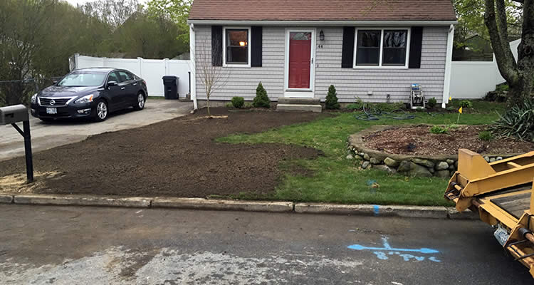 A new spetic hookup in the front yard of a Rhode Island home that was installed by Grenco Septic Systems and Installation